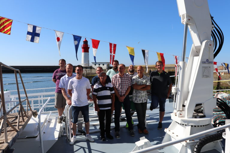 The crew of the new trawler and Armement Bigouden staff on board Bara An Arvoriz